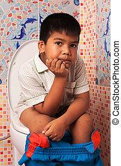 little asian boy defecate in toilet background