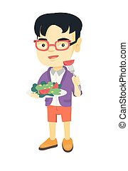 Little asian boy eating vegetable salad.