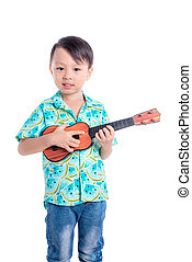 Little asian boy playing guitar toy over white