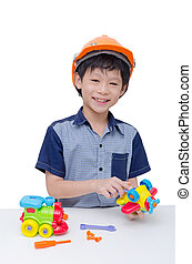 boy playing with plane and train toy