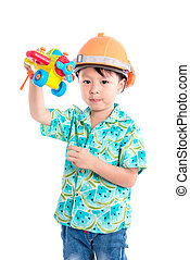 Little asian boy wear helmet and play plastic plane