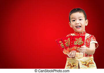 Little Asian boy wearing red traditional Chinese suit and holdin