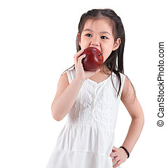 Asian child eating an apple