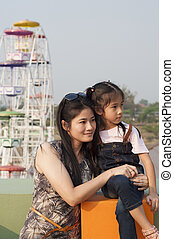 Little Asian girl and mom.