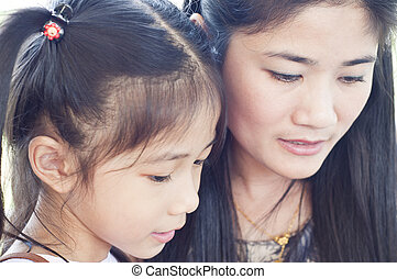 Little Asian girl and mother.