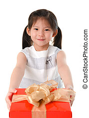 Little Asian girl arms out holding a beautiful wrapped present