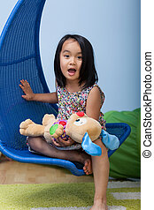 Little asian girl at home