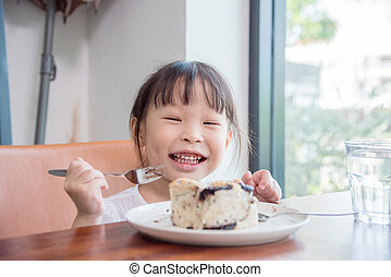 girl eating bread with chocolate at home
