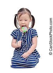 girl eating lollipop over white