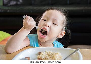 girl having lunch by fork