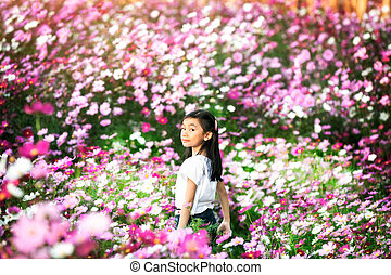 Little asian girl in a garden