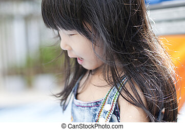 little Asian girl in playground.