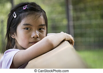 Little Asian girl looking at camera