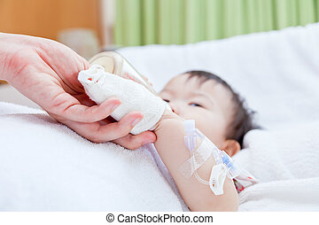 Little asian girl lying on a medical bed