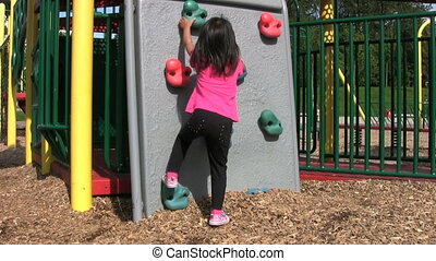 Little Asian Girl On A Climbing Wal