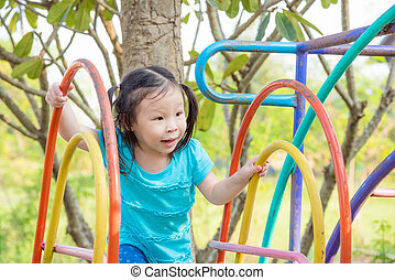 girl playing in playground