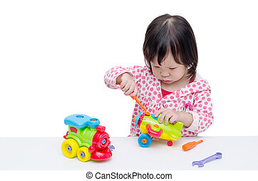 girl playing with plane and train toy