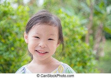 girl smiling in park