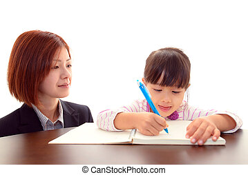Little Asian girl studying with tea