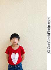Little Asian girl thinking