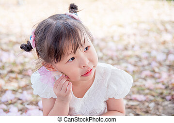 girl with flower in park