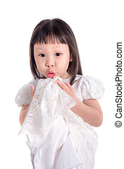 Little asian girl with funny face over white background