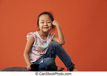 Little asian kid with smartphone