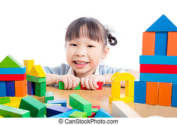 girl playing colorful wood block over white background