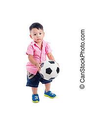 Little asian preschool boy holding ball over white background