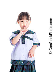 student doing keep quiet sign over white background