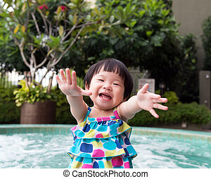 Little Asian toddler at the pool