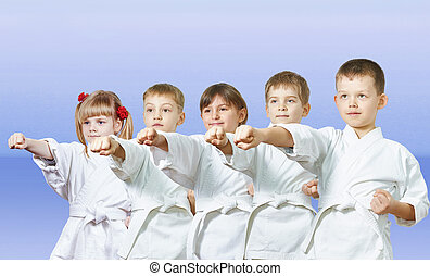 Little athletes beats punch arm - On a light background the ...