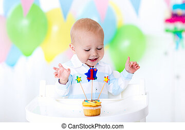 Little baby boy celebrating first birthday - Adorable baby...