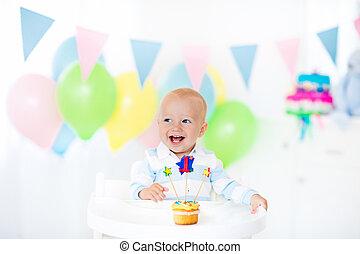 Little baby boy celebrating first birthday