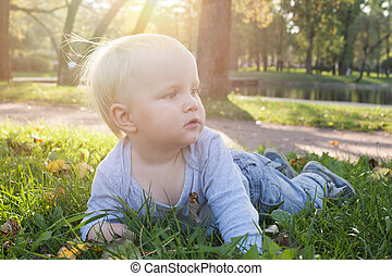 Little baby boy outdoors in park