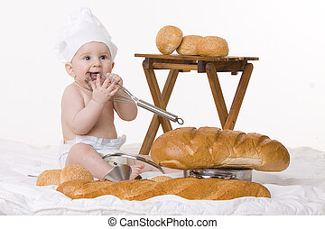 little baby chef, baguettes and bread on white background