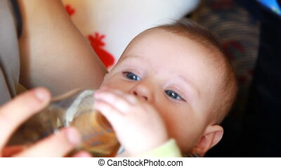 Little baby drinking, close up
