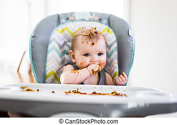 Little baby eating her dinner and making a mess - A Little...