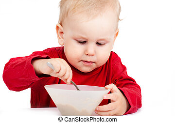 Little baby eating with spoon