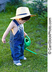 little baby gardener lost in his task at hand