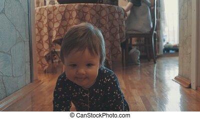 Little baby girl crawling on the floor. Steadicam shot 4K.