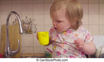Little baby girl drinking water
