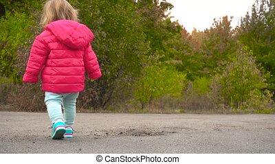 Little baby girl in autumn park
