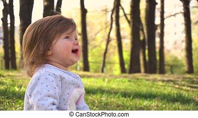 Little baby girl in the summer park