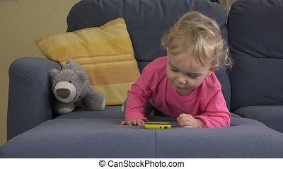 little baby girl interest mobile smart phone. 4K - little...