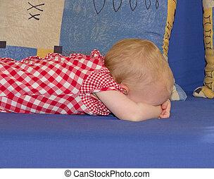 Little baby girl lying face down