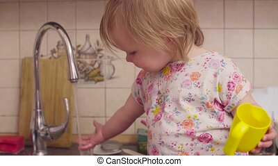 Little baby girl playing with water - Little baby girl...