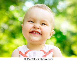 Little Baby Girl Portrait outdoor. Child over nature background