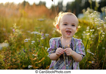 Little baby in a meadow