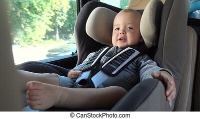 Little baby in booster chair in car - Little charming baby...